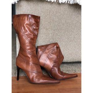 Brown, knee high, high heel boots.